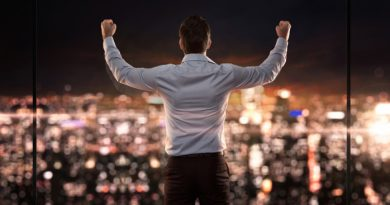 A successful Forex trader raising his hands up in celebration