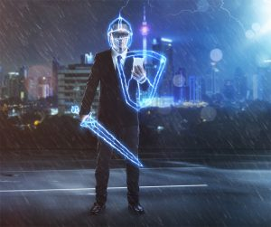 Businessman standing with a sword and shield - signifying risk management